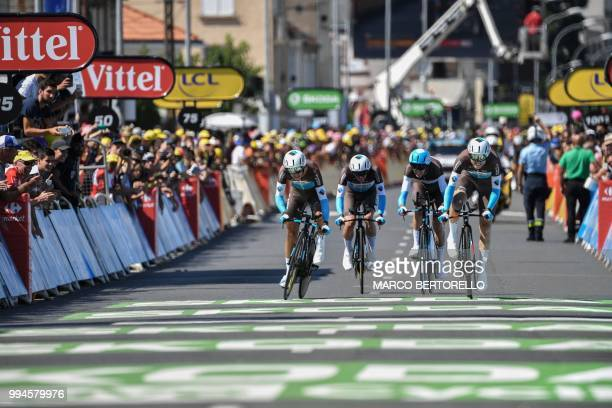 Riders of France's AG2R La Mondiale cycling team cross the finish line of the third stage of the 105th edition of the Tour de France cycling race a...
