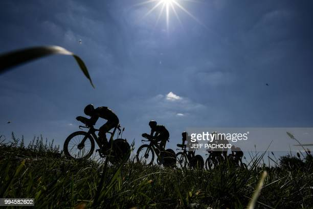 TOPSHOT Riders of France's Direct Energie cycling team pedal during the third stage of the 105th edition of the Tour de France cycling race a 355 km...