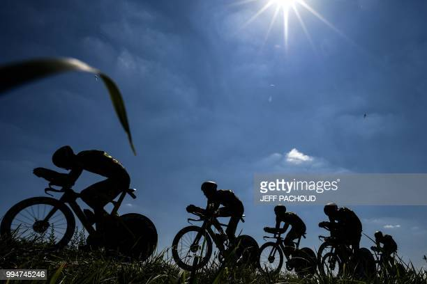 Riders of France's Direct Energie cycling team pedal during the third stage of the 105th edition of the Tour de France cycling race a 355 km team...