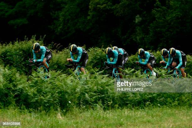 Riders of France's Fortuneo - Vital Concept cycling team compete during the third stage of the 70th edition of the Criterium du Dauphine cycling...
