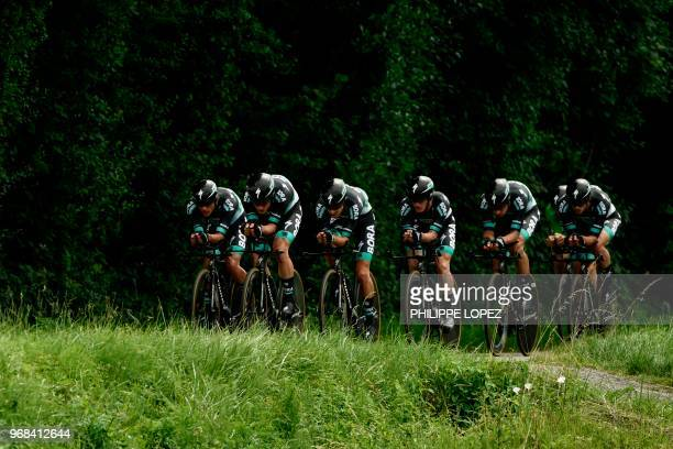 Riders of Germany's BoraHansgrohe cycling team compete during the third stage of the 70th edition of the Criterium du Dauphine cycling race a...