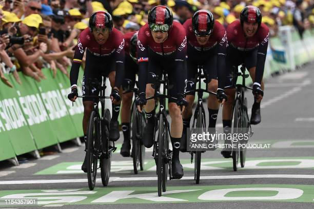 Riders of Great Britain's Team Ineos cycling team sprint few metres before the finish line in the second stage of the 106th edition of the Tour de...