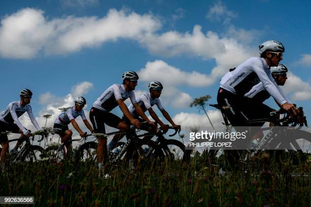Riders of Great Britain's Team Sky cycling team pedal during a training session on July 6, 2018 near Saint-Mars la Reorthe, western France, on the...