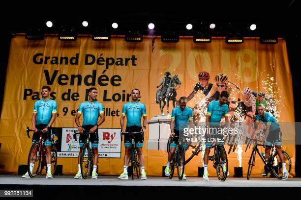 Riders of Kazakhstan's Astana Pro cycling team stand on stage during the team presentation ceremony on July 5 2018 in La RochesurYon western France...