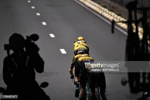 Riders of Netherlands' Jumbo-Visma cycling team compete in the second stage of the 106th edition of the Tour de France cycling race, a 27.6km team...