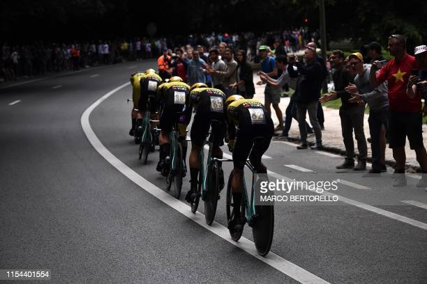 Riders of Netherlands' JumboVisma cycling team compete in the second stage of the 106th edition of the Tour de France cycling race a 276km team...