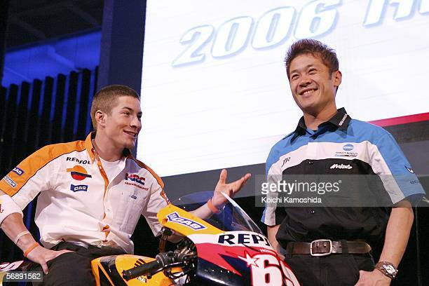 Riders of Repsol Honda Team MotoGP Nicky Hayden of America and JiR Konica Minolta Honda Team Makoto Tamada of Japan pose during a press conference...
