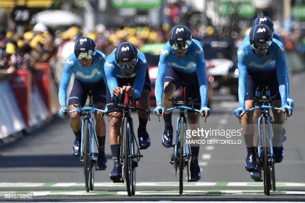 Riders of Spain's Movistar Team cycling team cross the finish line of the third stage of the 105th edition of the Tour de France cycling race, a 35.5...
