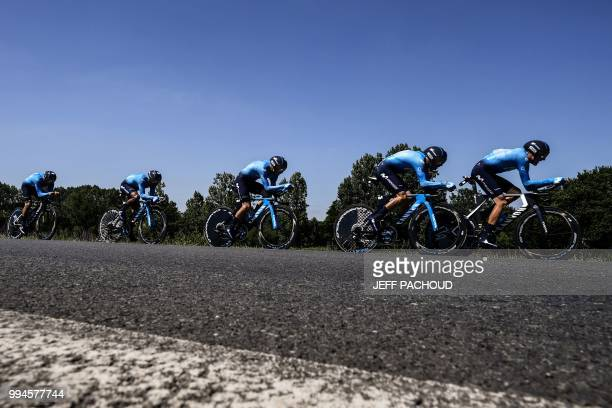 Riders of Spain's Movistar Team cycling team pedal during the third stage of the 105th edition of the Tour de France cycling race, a 35.5 km team...