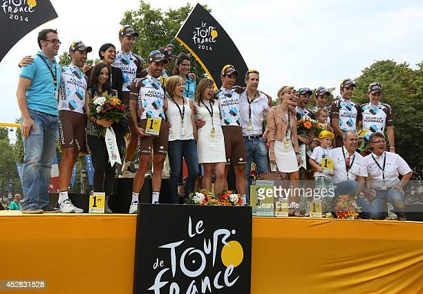 Riders of Team AG2R La Mondiale along their families celebrate on the podium their best team trophy after the twenty one and last stage of the 2014...