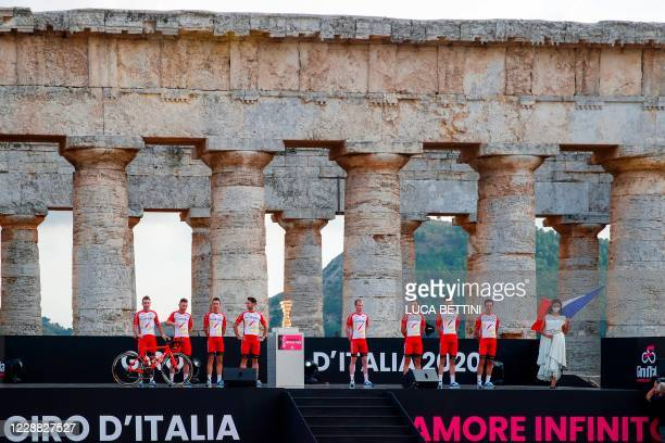 Riders of the Cofidis Team pose on stage at the Doric Temple of Segesta, near Palermo, Sicily, on October 1, 2020 during an opening ceremony of...