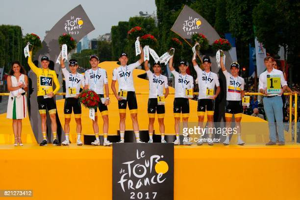Riders of the Great Britain's Sky cycling team Great Britain's Christopher Froome wearing the overall leader's yellow jersey Poland's Michal...