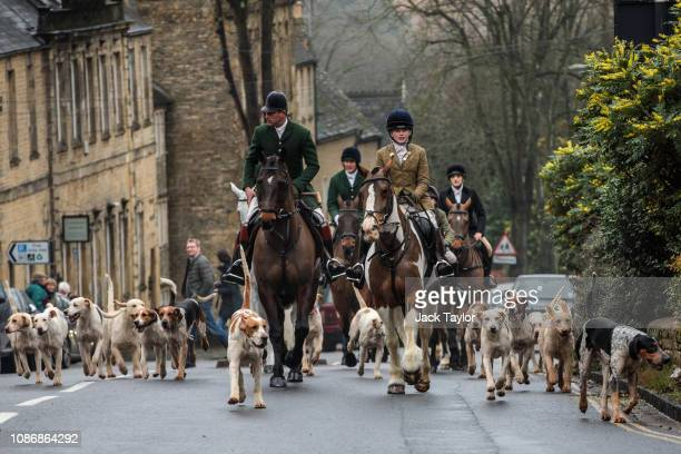 Riders of the Heythrop Hunt and their hounds arrive in the Chipping Norton town centre on Boxing Day on December 26 2018 in Oxfordshire England...