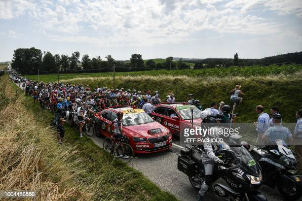 Riders of the pack wait for the race to resume after General Director of the Tour de France France's Christian Prudhomme halted it following a...