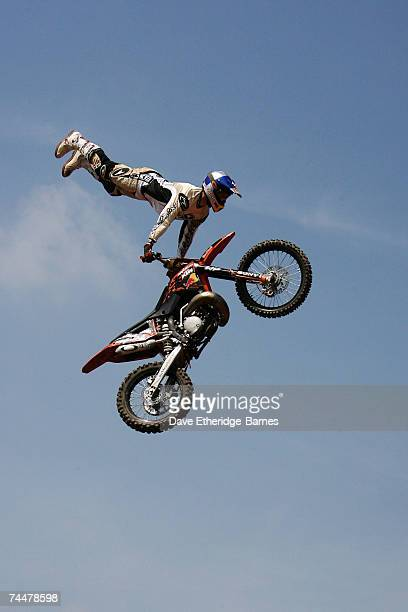 Riders of the Red Bull XFighters perform Freestyle Motocross during day two of the Download Festival at Donington Park on June 9 2007 in Donington...