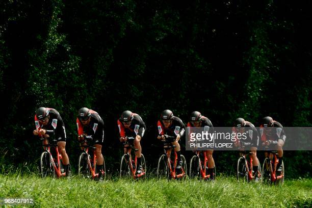 Riders of USA's BMC Racing cycling team compete during the third stage of the 70th edition of the Criterium du Dauphine cycling race a 35kilometer...