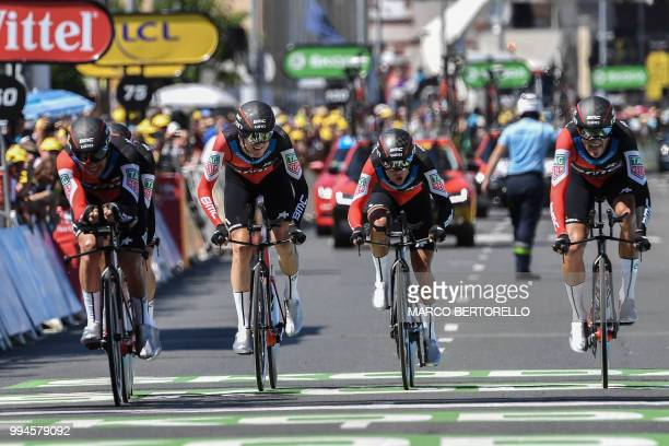 TOPSHOT Riders of USA's BMC Racing cycling team cross the finish line of the third stage of the 105th edition of the Tour de France cycling race a...