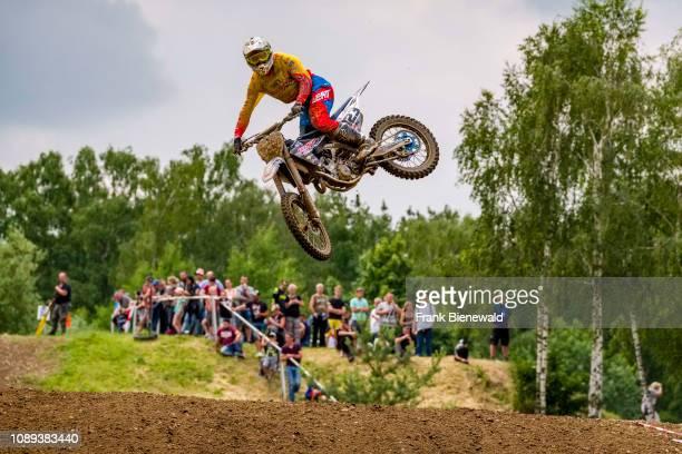 Riders on 250 cc motocross bikes jumping at Deutsche Meisterschaft at the motocross circuit Am Österreicher.