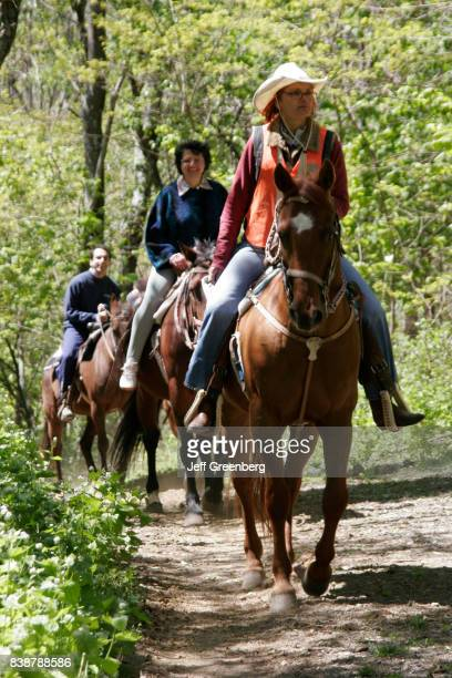 Riders on horses on the Limberlost Trail at Skyland Resort,