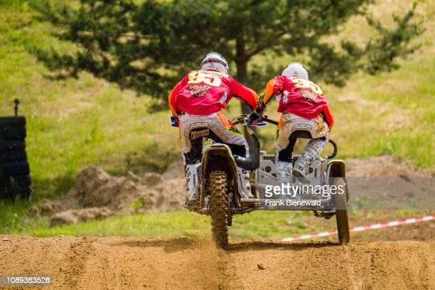 Riders on sidecar motocross bikes at Deutsche Meisterschaft at the motocross circuit Am Österreicher.