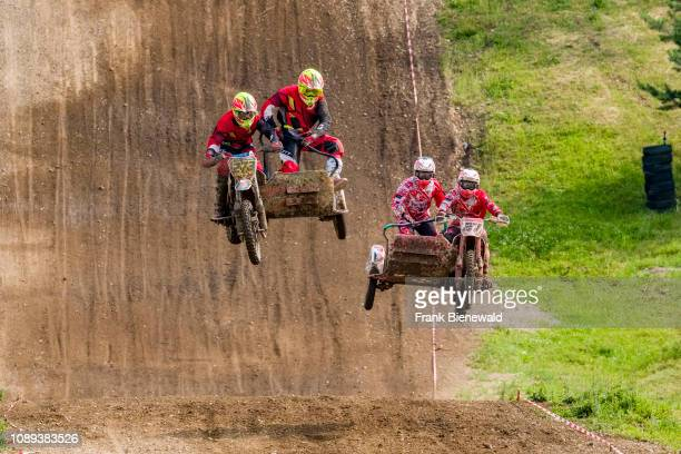Riders on sidecar motocross bikes jumping at Deutsche Meisterschaft at the motocross circuit Am Österreicher.