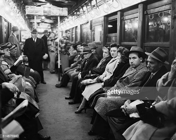 Riders on the New York subway system sit without newspapers during a newspaper strike in the city