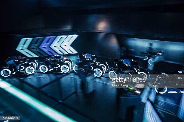 Riders on the Tron Lightcyle Power Run rollercoaster begin their ride at Walt Disney Co's Shanghai Disneyland theme park during a trial run ahead of...