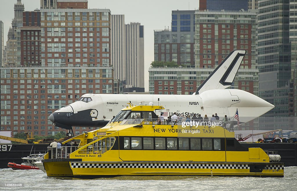 Riders onboard a New York Water Taxi get a close-up view of the space shuttle Enterprise as it is towed by barge up the Hudson on June 6, 2012 in New York City. The shuttle is on it's way to the USS Intrepid, where it be on display for viewing by the general public. NASA's space shuttle program came to an end in August, 2011, after 30 years of service.