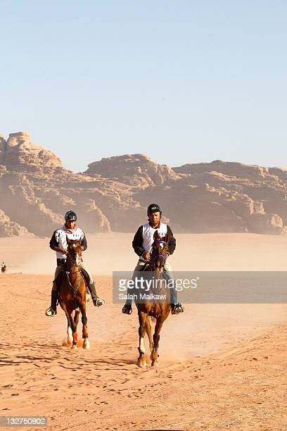 Riders participate in the International Wadi Rum Endurance Horse Race on November 14 2011 in Wadi Rum Jordan Participants from different Arab and...