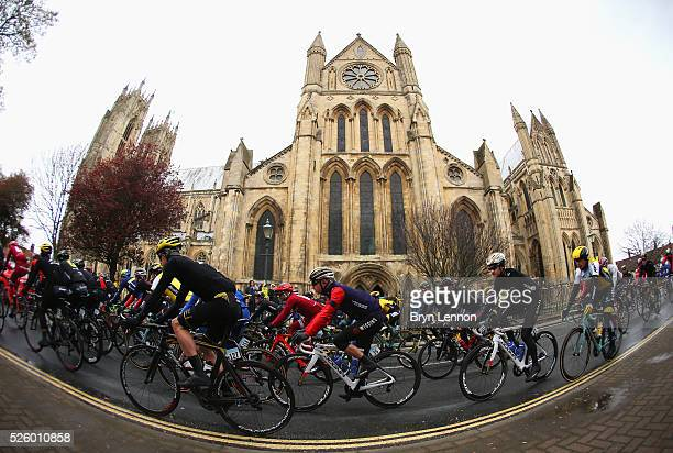 Riders pass a church at the start of the first stage of the 2016 Tour de Yorkshire from Beverley to Settle on April 29, 2016 in Beverley, England.