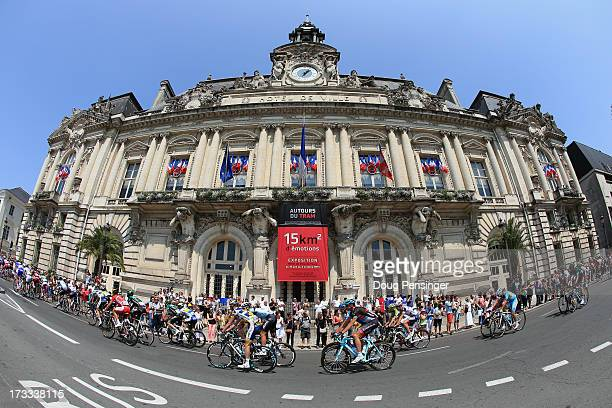 Riders pass by the Hotel De Ville as they start stage thirteen of the 2013 Tour de France, a 173KM road stage from Tours to Saint-Amand-Montrond on...