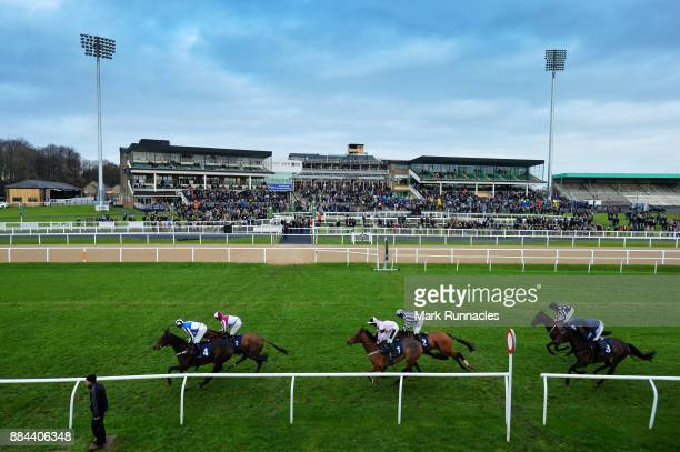 Riders pass the grandstand during the Weatherbys Racing Bank 'The French Furze' Novice Hurdle Race at Newcastle Racecourse on December 2 2017 in...