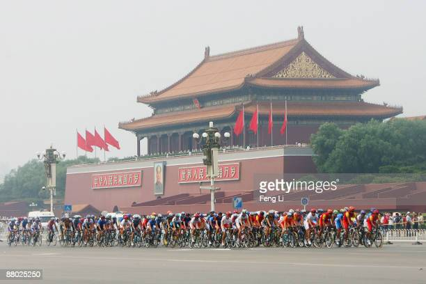 Riders pass the Tiananmen Square during the Men's Road Race at the Good Luck Beijing Road Cycling International Invitational on August 18, 2007 in...