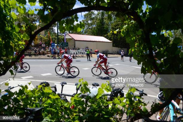 Riders pass through the town of Williamstown on the first day of the Tour Down Under cycling race in the Adelaide suburbs on January 16 2018 / AFP...