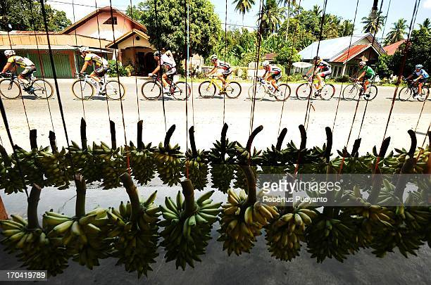 Riders pass trough banana seller during Stage 6 Tour de Singkarak 2013 start from Pariaman to Painan.
