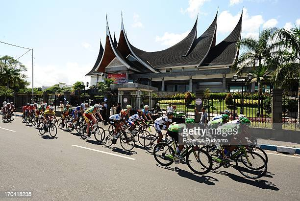 Riders pass trough Indonesian Central Bank of West Sumatra Building in Padang, Indonesia during the Stage 6 Tour de Singkarak 2013. Distance 144,5 km.