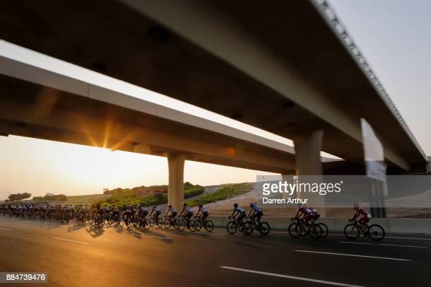 Riders pass under a bridge during the Abu Dhabi Al Ain Classic on December 3 2017 in Abu Dhabi Unite