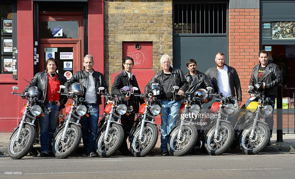 Riders (L-R) Paul Blezard, Duncan Moore, Hiroyuki Maeda, Rick Kemp, Joshua Crasto, Dan Cartwright and Rod Gaskell pose at the Royal Enfield store ahead of a motorcycle ride to the Goodwood Revival to celebrate the unveiling of their new accessory range inspired by World War 2 dispatch riders on September 12, 2014 in London, England.