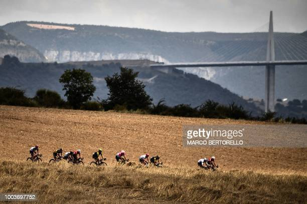 The pack rides during the 15th stage of the 105th edition of the Tour de France cycling race between Millau and Carcassonne on July 22 2018