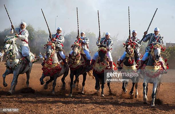 Riders perform traditional equestrian performance called Tebburide on the second day of 7th El Jadida Horse Fair in El Jadida Morocco on October 22...