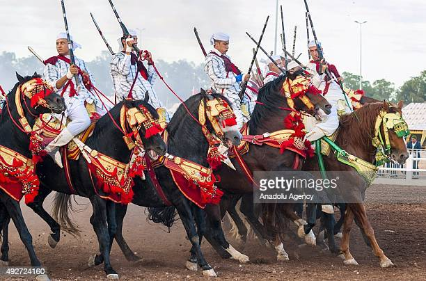 Riders perform traditional equestrian performance called Tebburide on the second day of 8th El Jadida Horse Fair in El Jadida Morocco on October 14...