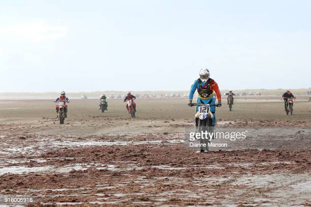 Riders race along Oreti Beach during the Indian Motorcycle NZ Beach Racing Champs on February 9 2018 in Invercargill New Zealand