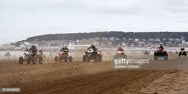 Riders race down the beach during the Adult Quad and Sidecar race at the 2016 HydroGarden Weston Beach Race in WestonsuperMare south west England on...