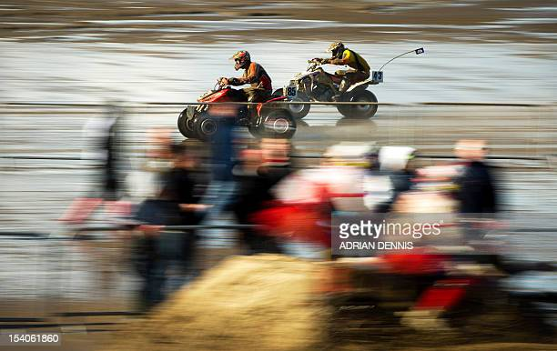 Riders race their quad bikes during the main quad and sidecar race during the 2012 RHL Weston beach race in WestonSuperMare southwest England on...