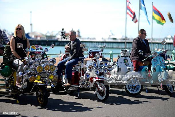 Riders relax on their scooters during the Brighton Mod weekender on August 24 2014 in Brighton England This August Bank holiday will see many Mods...