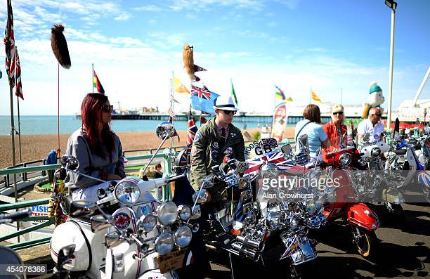 Riders sit on their scooters during the Brighton Mod weekender on August 24 2014 in Brighton England This August Bank holiday will see many Mods and...