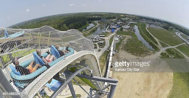 Riders slide down Verruckt the world's tallest water slide at the Schlitterbahn Kansas City Waterpark on Wednesday July 9 2014 in Kansas City Kan