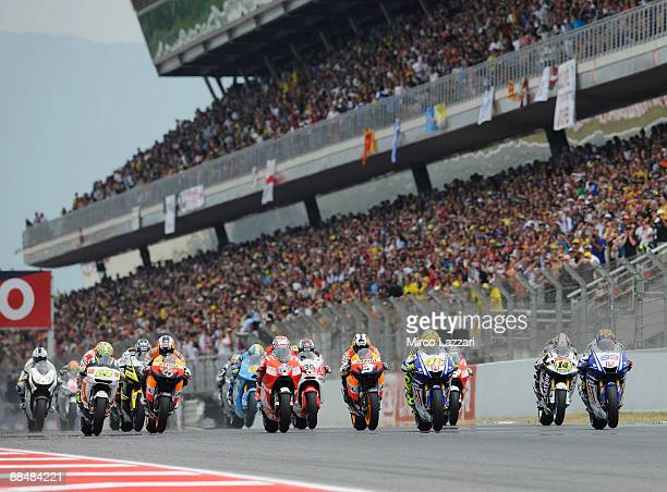 Riders speed off the start line during the MotoGP race at the Montmelo Circuit on June 14, 2009 in Barcelona, Spain.