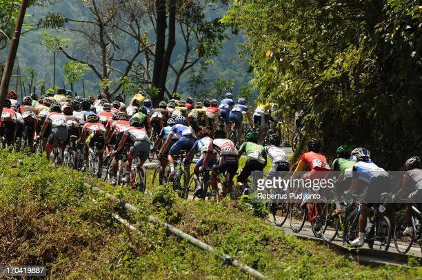 CONTENT] Riders speeding their bike in high hill during the Stage 6 Tour de Singkarak 2013 start from Gandoriah Beach Pariaman to Painan distance...