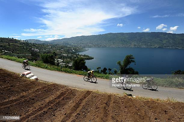 Riders speeding their bike in stage 5 Tour de Singkarak 2013 start from Sawahlunto to Muara Labuh pass through alongside of the beautiful Twin Lake...